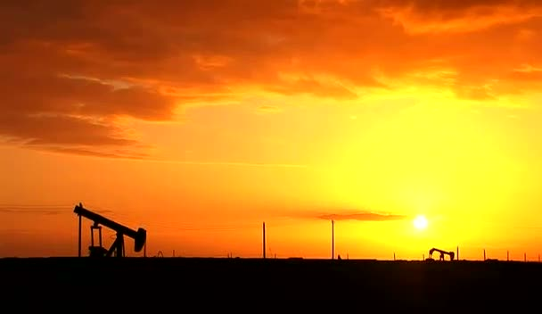 Sun Setting on an Oil Field
